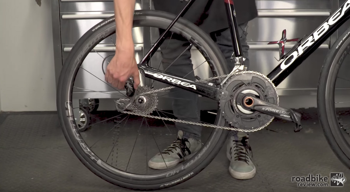 Put your chain in the smallest cog before removing your wheel.