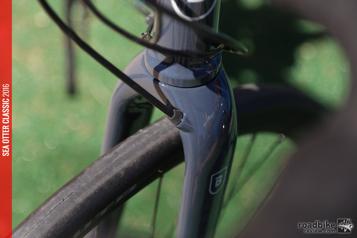 Carbon fork with carbon steerer has slick internal routing of the disc brake lines.