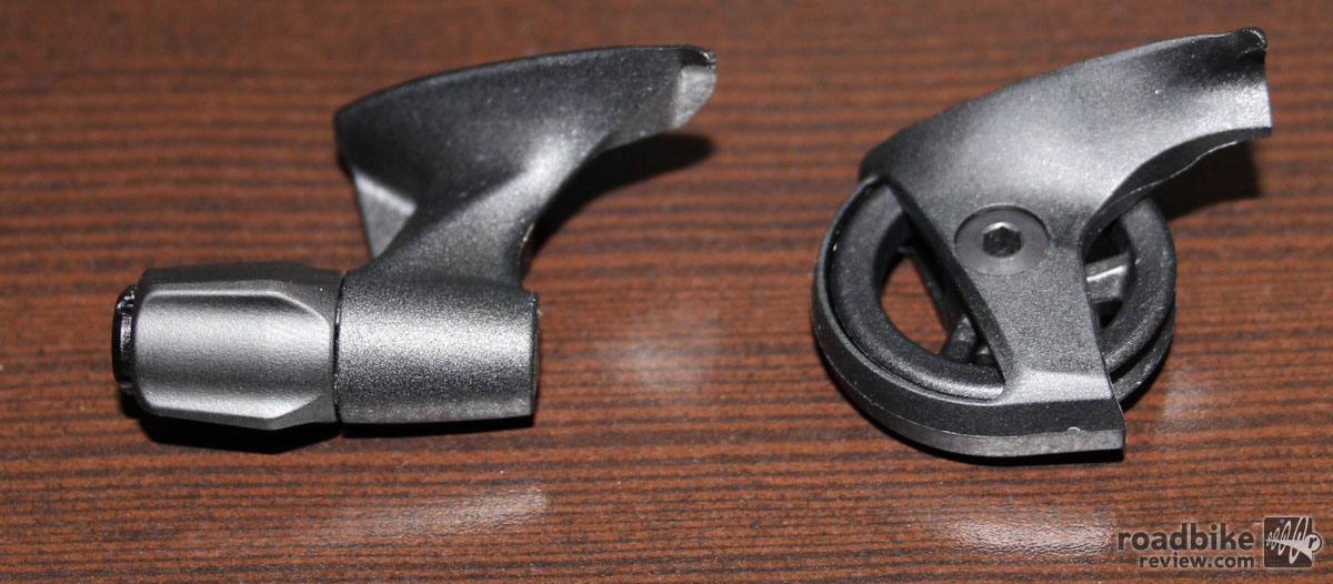 These two cable routers (Left: Force CX-1, Right: X1 Mountain) are designed differently to change the angle of entry of the cable into the derailleur body. They are interchangeable between the two derailleurs, but it wouldn't do you much good as it will change the way the derailleur works. The CX-1 version has a built-in barrel adjuster since the shift lever doesn't have one like its X1 counterpart. Photo courtesy of Art's Cyclery