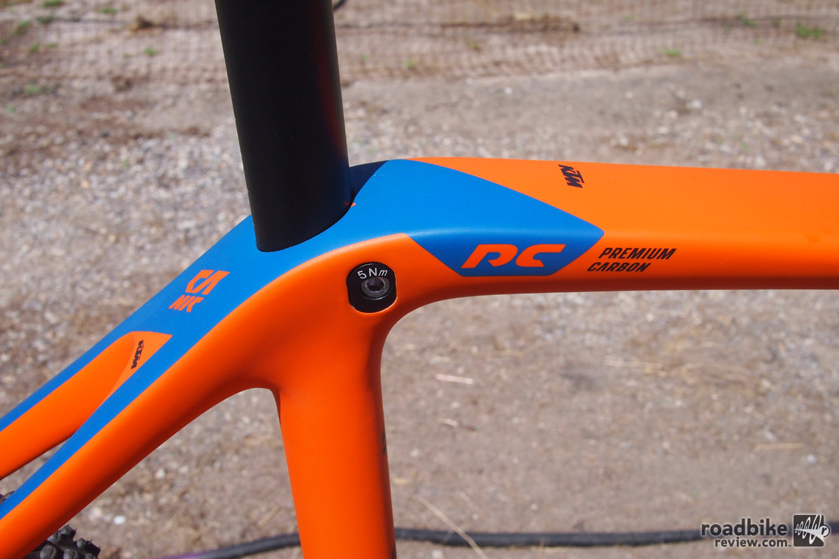 "The Canic frame features KTM's Performance Carbon and uses an interesting ""hidden"" seat post binder bolt."