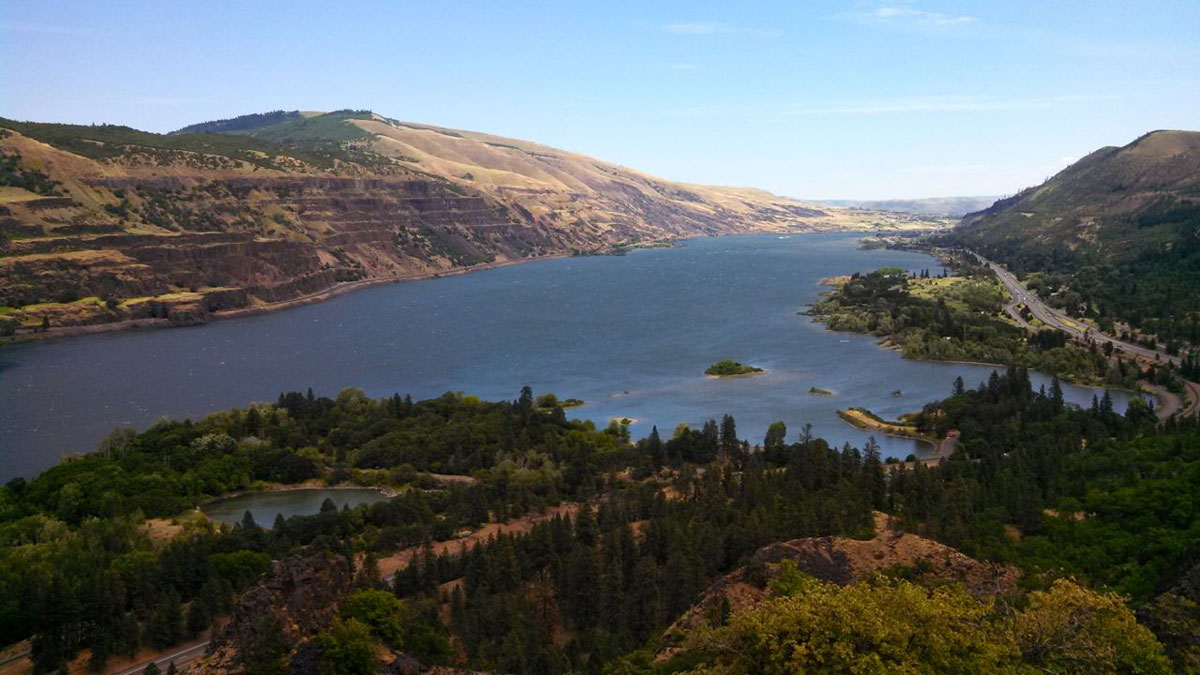 The Columbia River is more than a mile wide in spots with mountains rising high on either side.