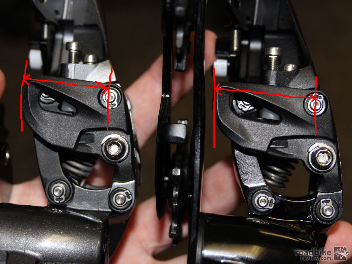 After running through the cable routers pictured previously, the cable runs around a lever arm guide before being clamped in the cable bolt. Comparing the two lever arms in the above picture, we can see how the length of the arm has changed to change the derailleur shift ratio so Force CX-1 will be compatible with 11-speed road instead of 11-speed mountain with a different cog pitch. Photo courtesy of Art's Cyclery