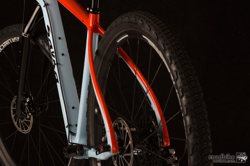 "Features include front and rear thru-axles, a large front triangle for extra frame bag gear space, and clearance for up to 29er x 2.4"" tires."