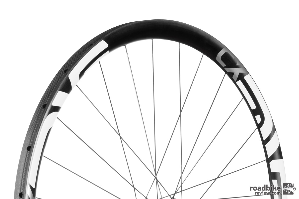 The rim is designed specifically for tires that fall within the UCI 33mm width limit, and the tire bed utilizes woven carbon fiber to provide a more durable surface for frequent tire installations and removals.
