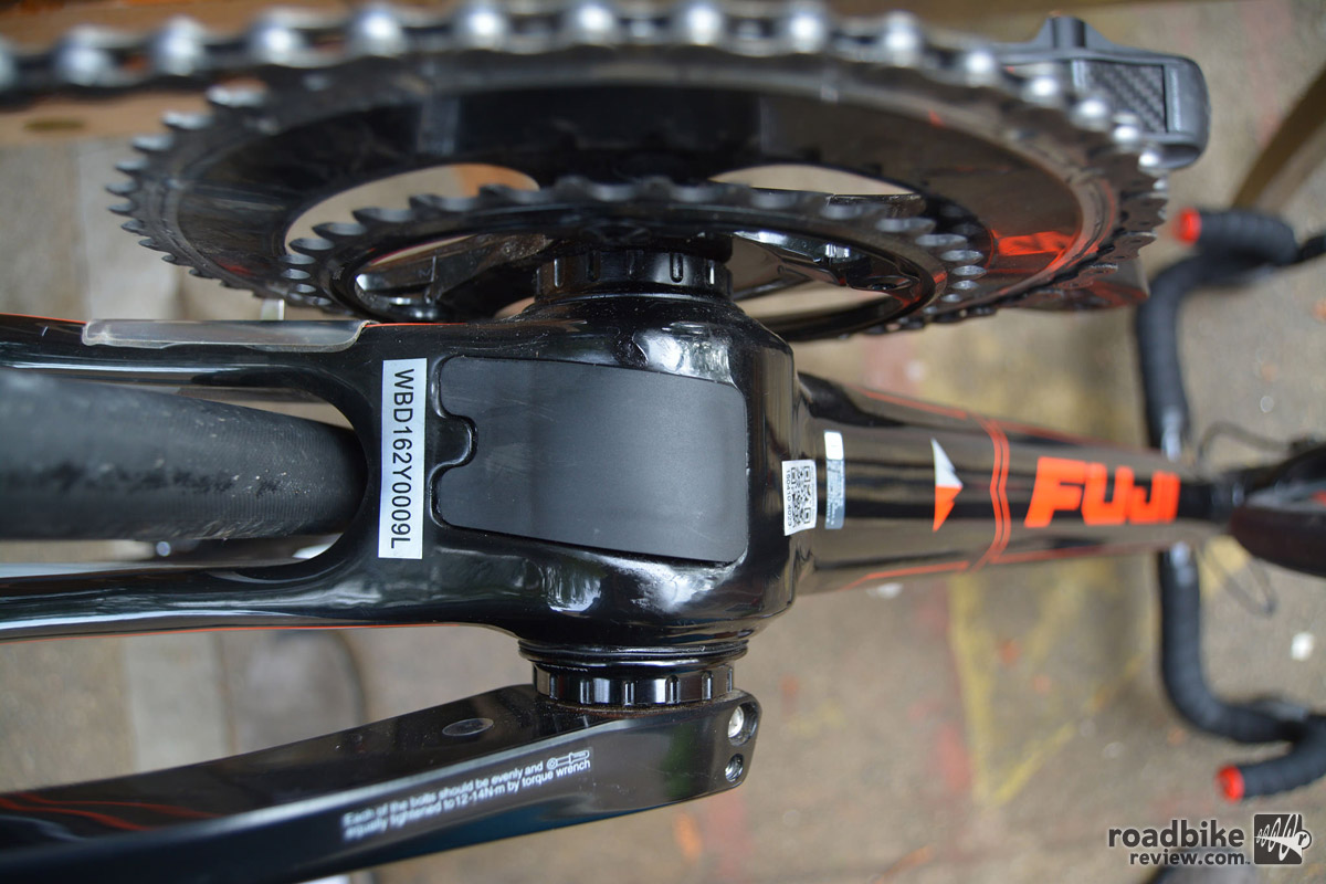 A removable plate on the underside of the bottom bracket aids in cable routing.