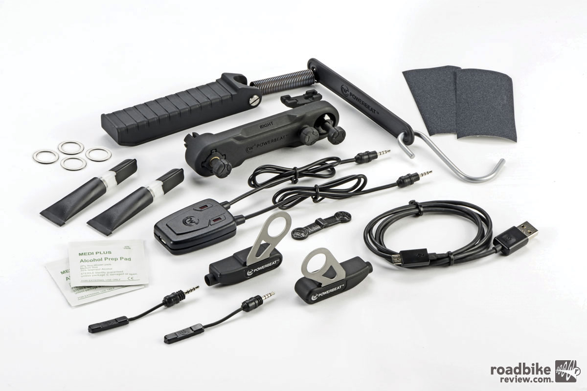 The PowerBeat kit includes two sensors that attach to a bike's crank and two comp units that attach to each pedal.