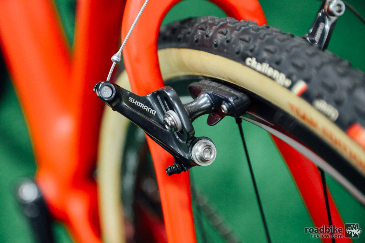 Disc brakes have their place, but canti brakes are lighter and easier to travel with.