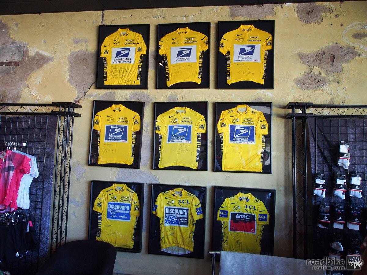 A quick tour of Hincapie Sports HQ in Greenville included this wall of Tour de France yellow jerseys, no asterisk included.
