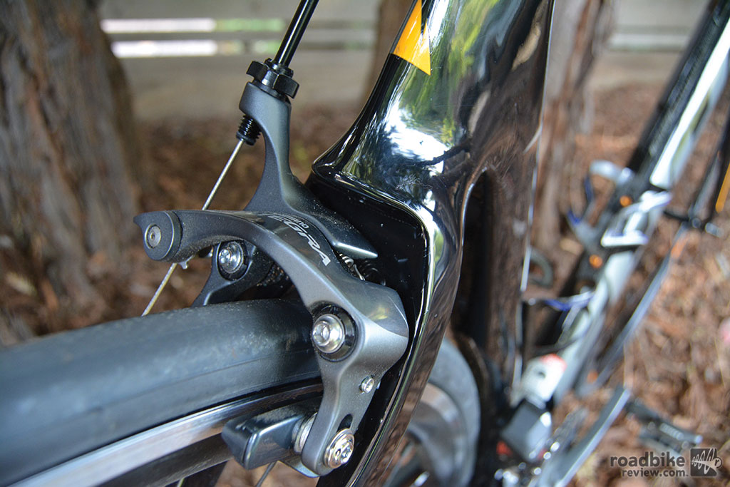 Integrated direct-mount brakes shielded from wind and out of the way.