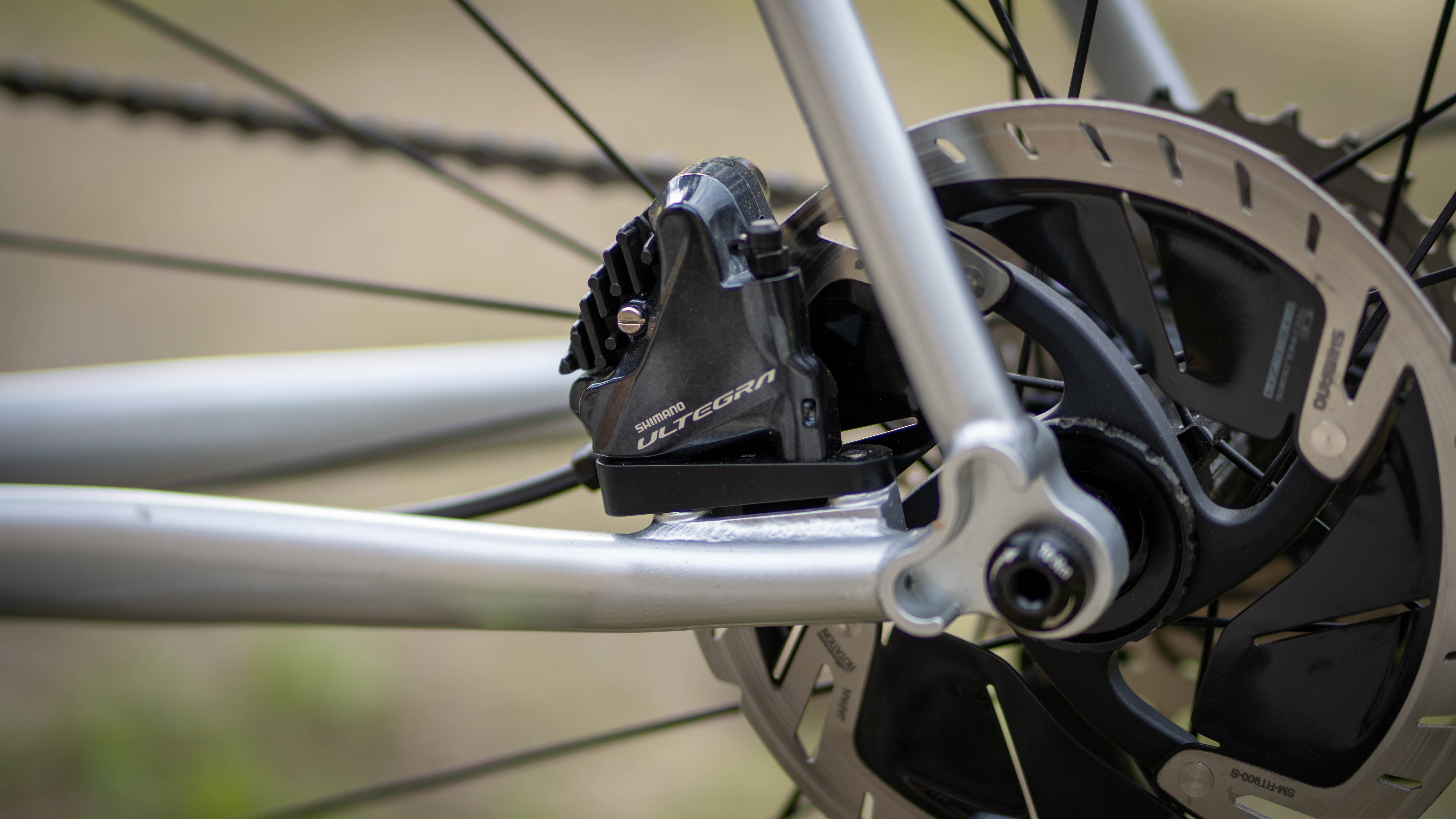 Direct-mount brakes are up to speed with current frame standards, but seem to spread the stays a bit wider, which resulted in a bit of heel rub.