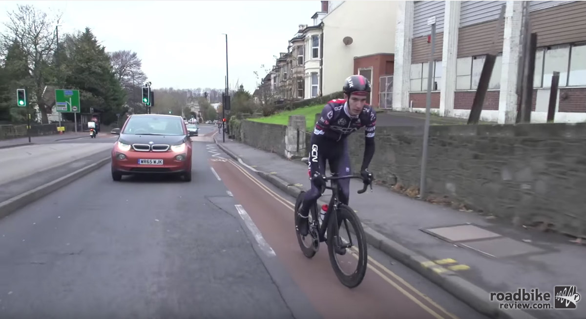 Using a bike is a way to lower our carbon footprint. But how does it compare to an electric car?