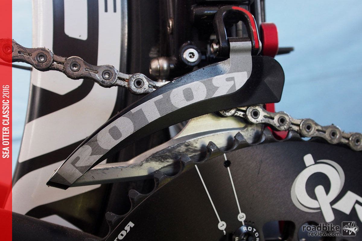 The front derailleur's rear cage plate is specifically designed to work with ovalized Rotor Q Rings.