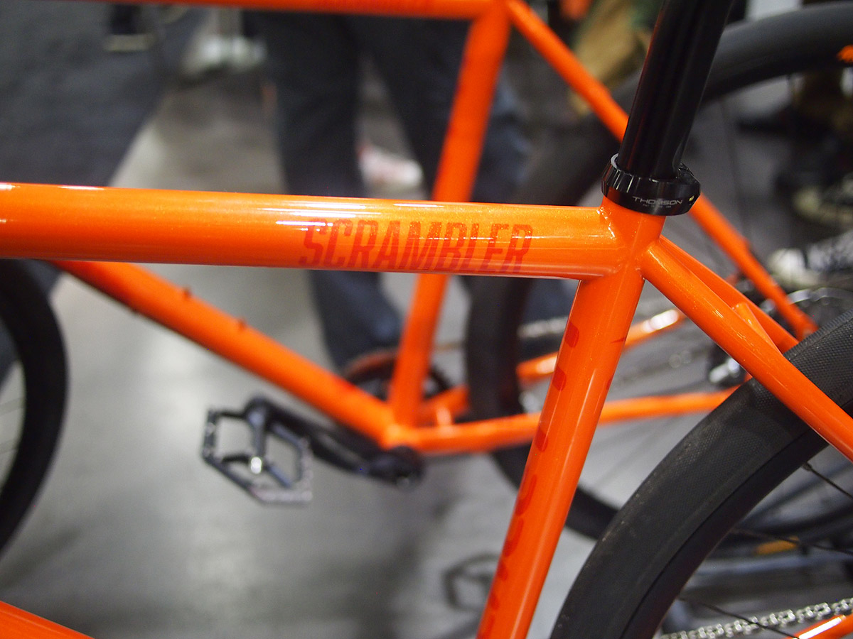 The orange paintwork features a metal flake sparkle to it.