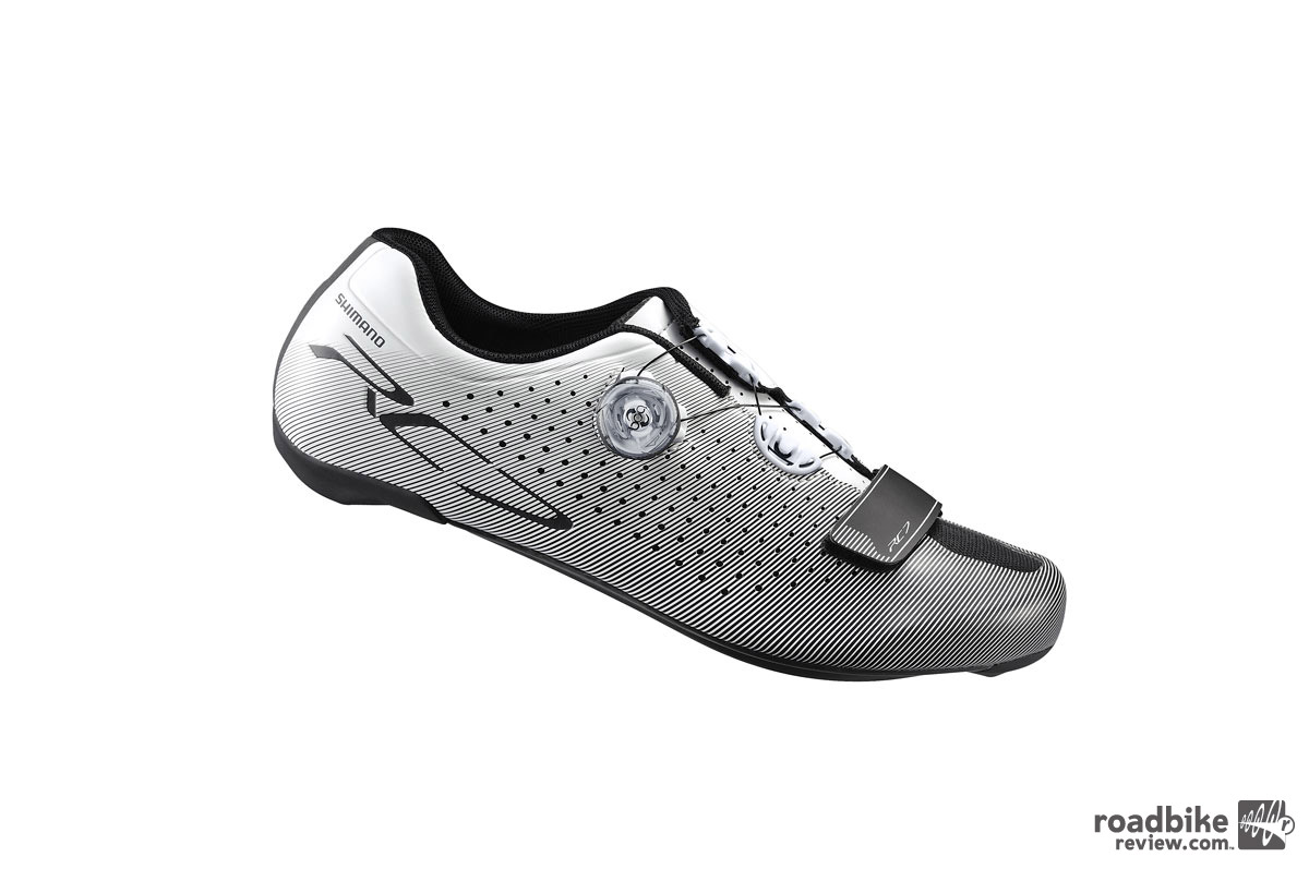 The RC7 uses a one-piece upper construction and a rigid carbon fiber composite sole to ensure efficiency and deliver light weight.