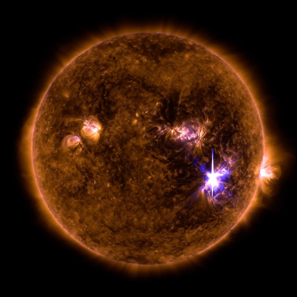 my daughter watched a shadow come down the stairs and go around the corner-solar-flare.jpg