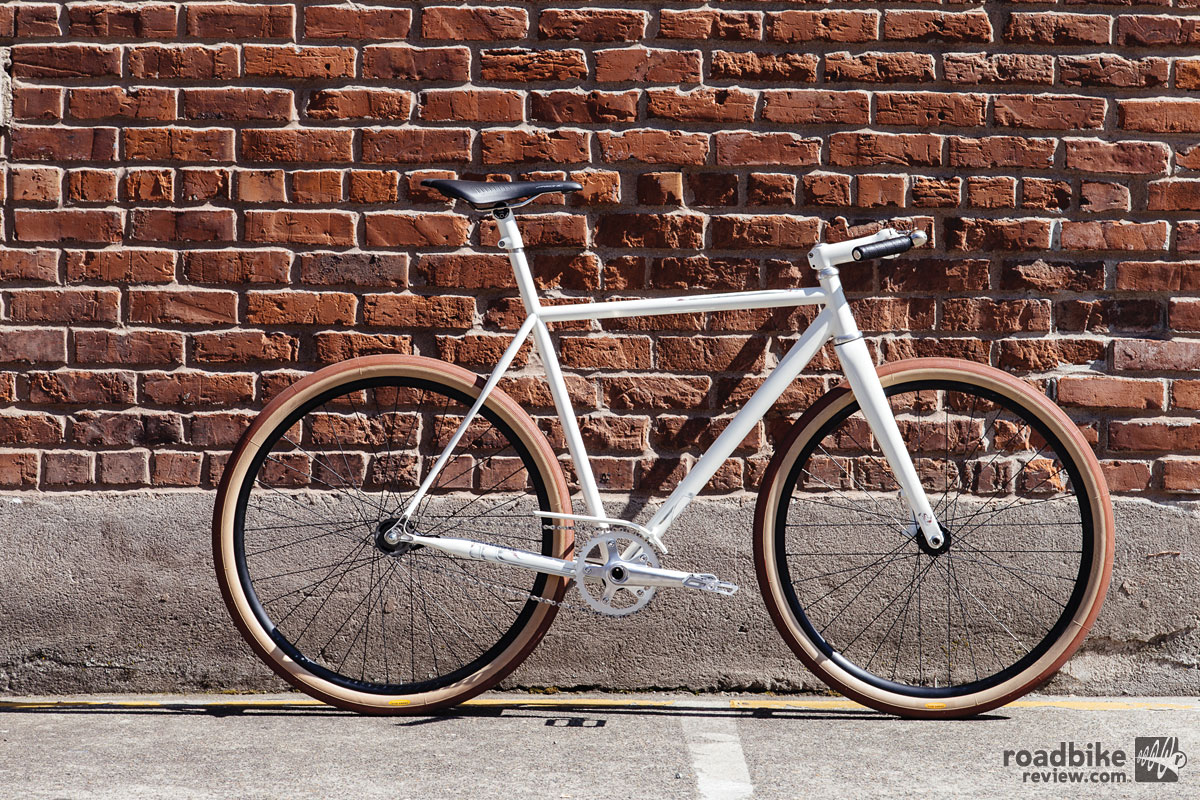 The Nitto handlebar is mostly flat, but has a little sweep. The handlebars are finished with leather bar wrap. Photo by John Watson/The Radavist