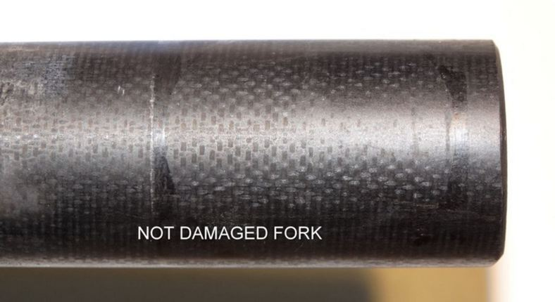 Are Marks (indent) on carbon fork from spacers normal?-steerer-ok2.jpg