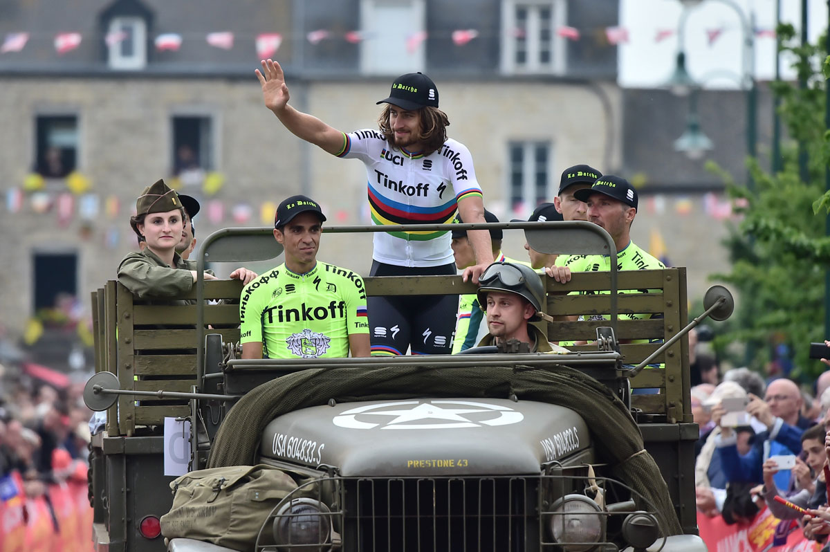 Reigning world champion Peter Sagan and overall GC contender Alberto Contador say hi to the fans during the team presentation.