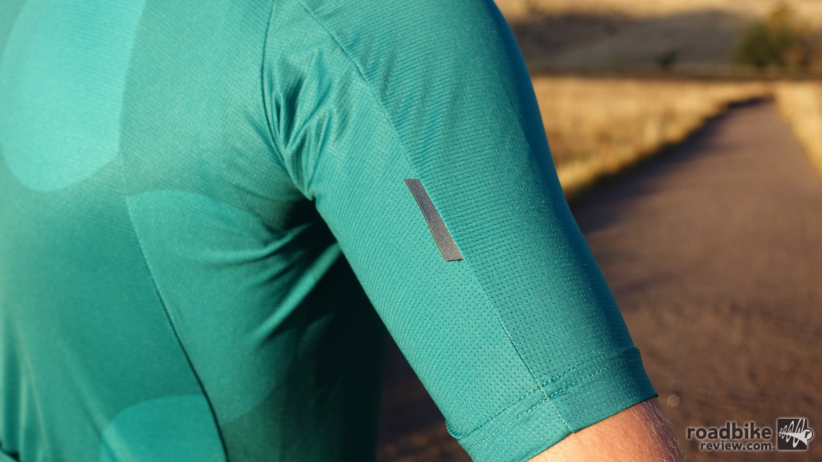 Longer sleeves and small reflective tabs keep you looking good and visible at the same time.