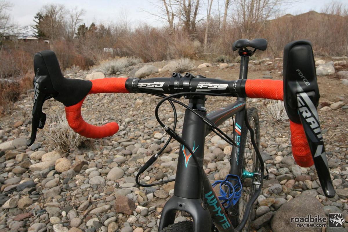 Shallow FSA Gossamer drop bars provide a semi-upright position good for trail riding.